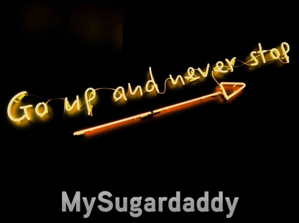Encouraging words: a neon sign written 'Go up and never stop'