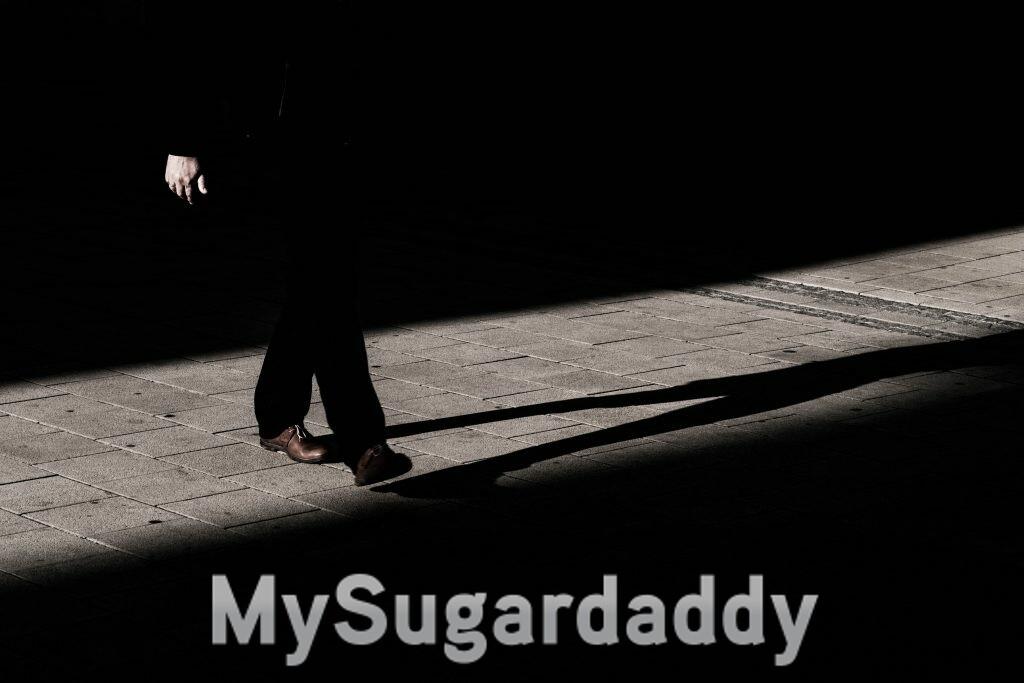 A Man walking suspiciously in the dark