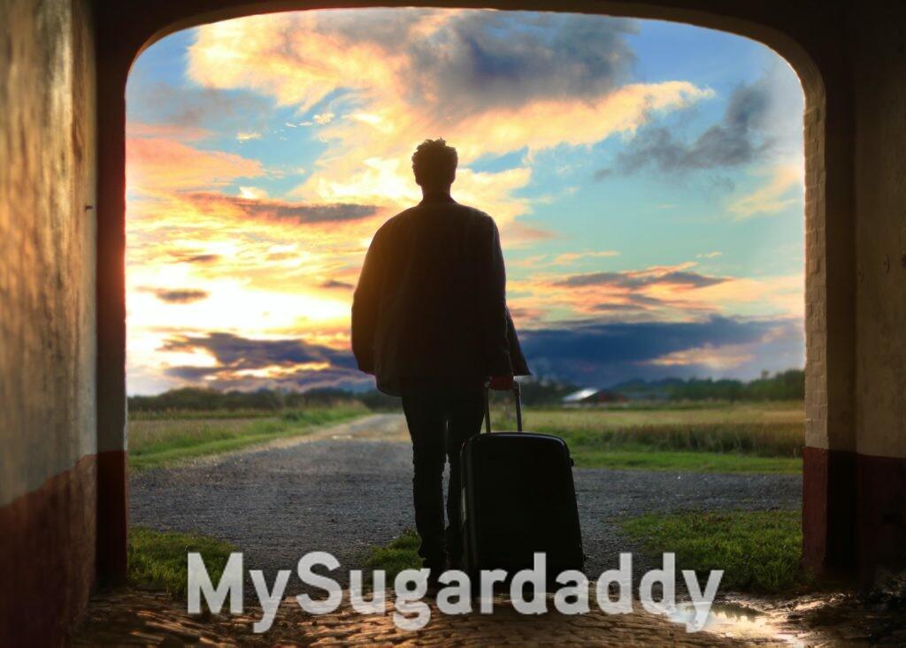 homem indo viajar puxando mala